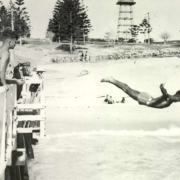 c 936 Bruce Gaston diving from the jetty